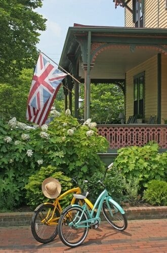 Photo of two Queen Victoria bicycles parked on The Queen Victoria brick driveway, with the Prince Albert Hall porch in the background.