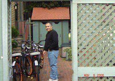 Guest Photos- Man next to Queen Victoria bikes.