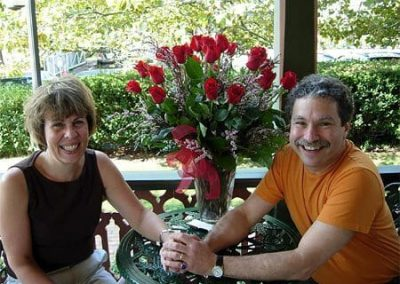 Guest Photos- Happy couple next to roses in vase at Queen Victoria