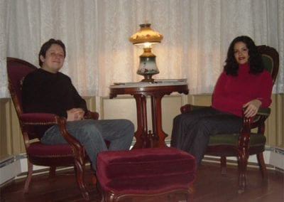 Guest Photos- Couple relaxing in chairs at Queen Victoria Bnb