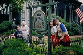 Guest Photos- Family standing next to the Queen Victoria sign.